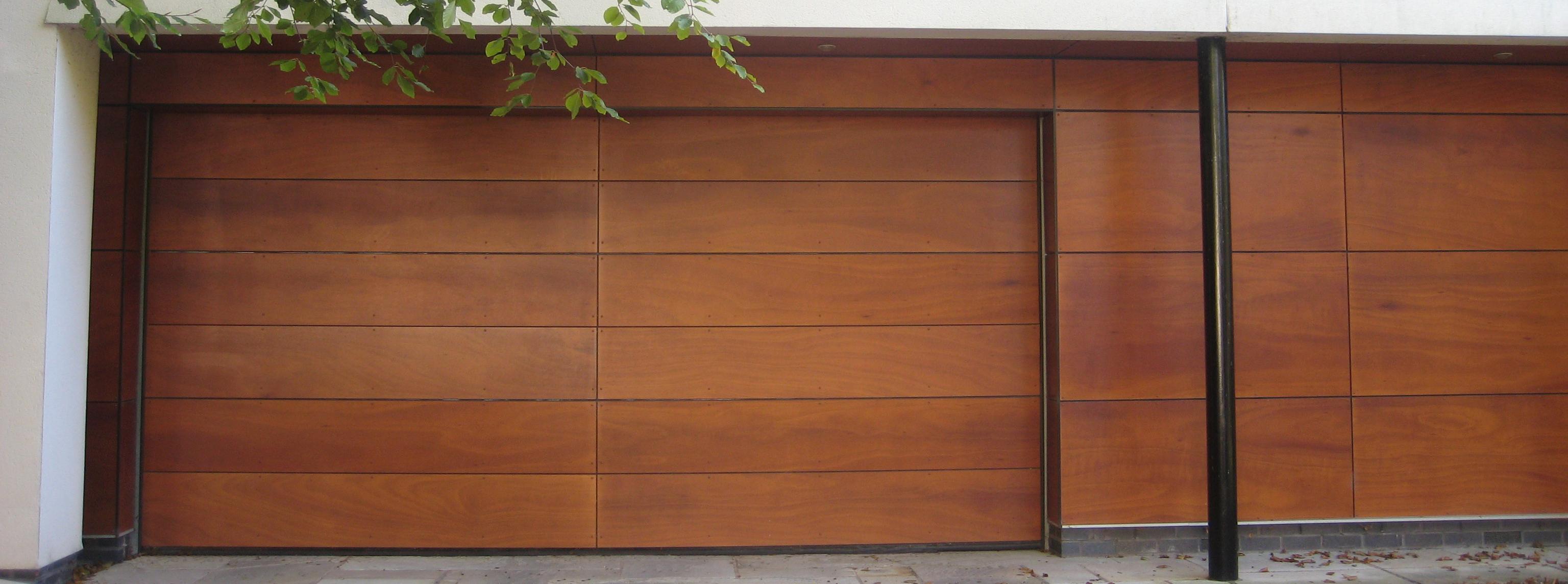 Sistemas automatizados para puertas de garaje puertas de - Puertas abatibles garaje ...
